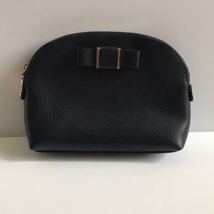 Coach makeup bag with bow detail